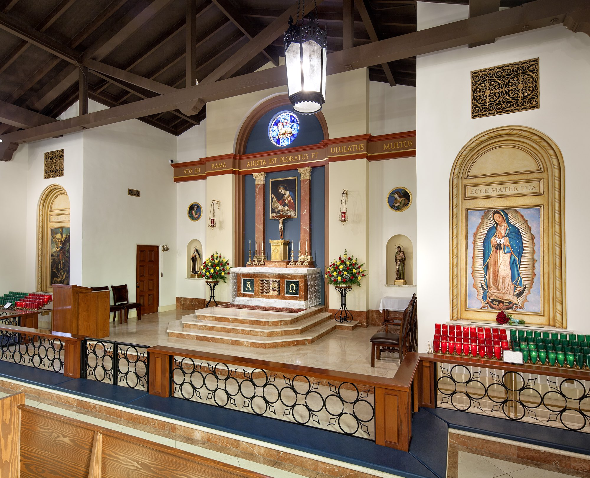 Marble altar sanctuary with gold our lady of Guadalupe and classical columns in mission style renovation by Harrison Design