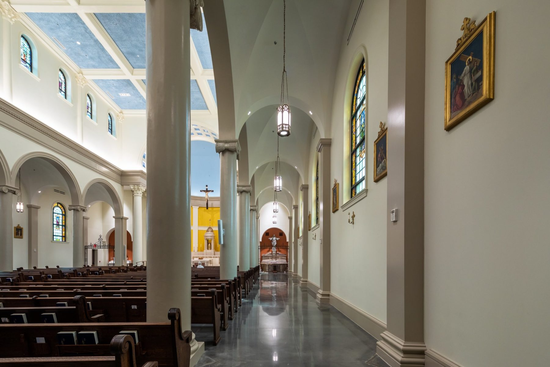 Ambulatory side aisle nave with Sacred heart of Jesus shrine visual termination polished concrete floor by Harrison Design
