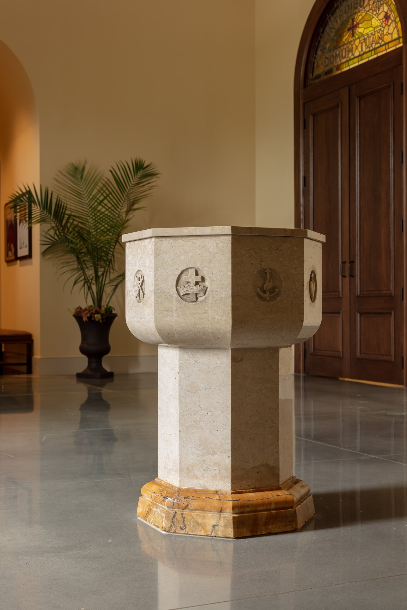 Marble and granite holy water font with Christian symbolism in narthex giallo antico octagon sculpture by Harrison Design