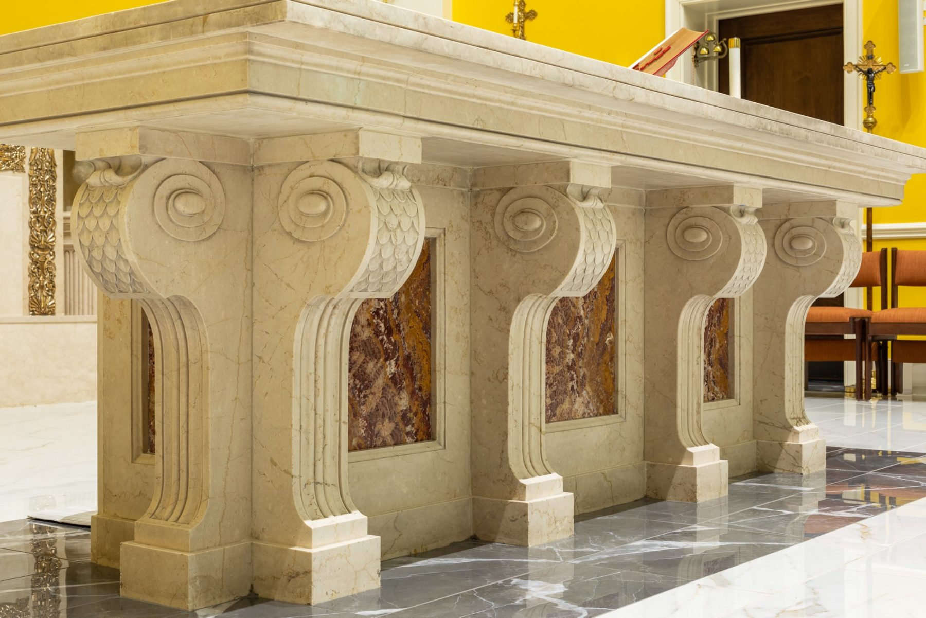Fine craftsmanship marble and granite scrolls on marble altar with classical details and panels architecture by Harrison Design