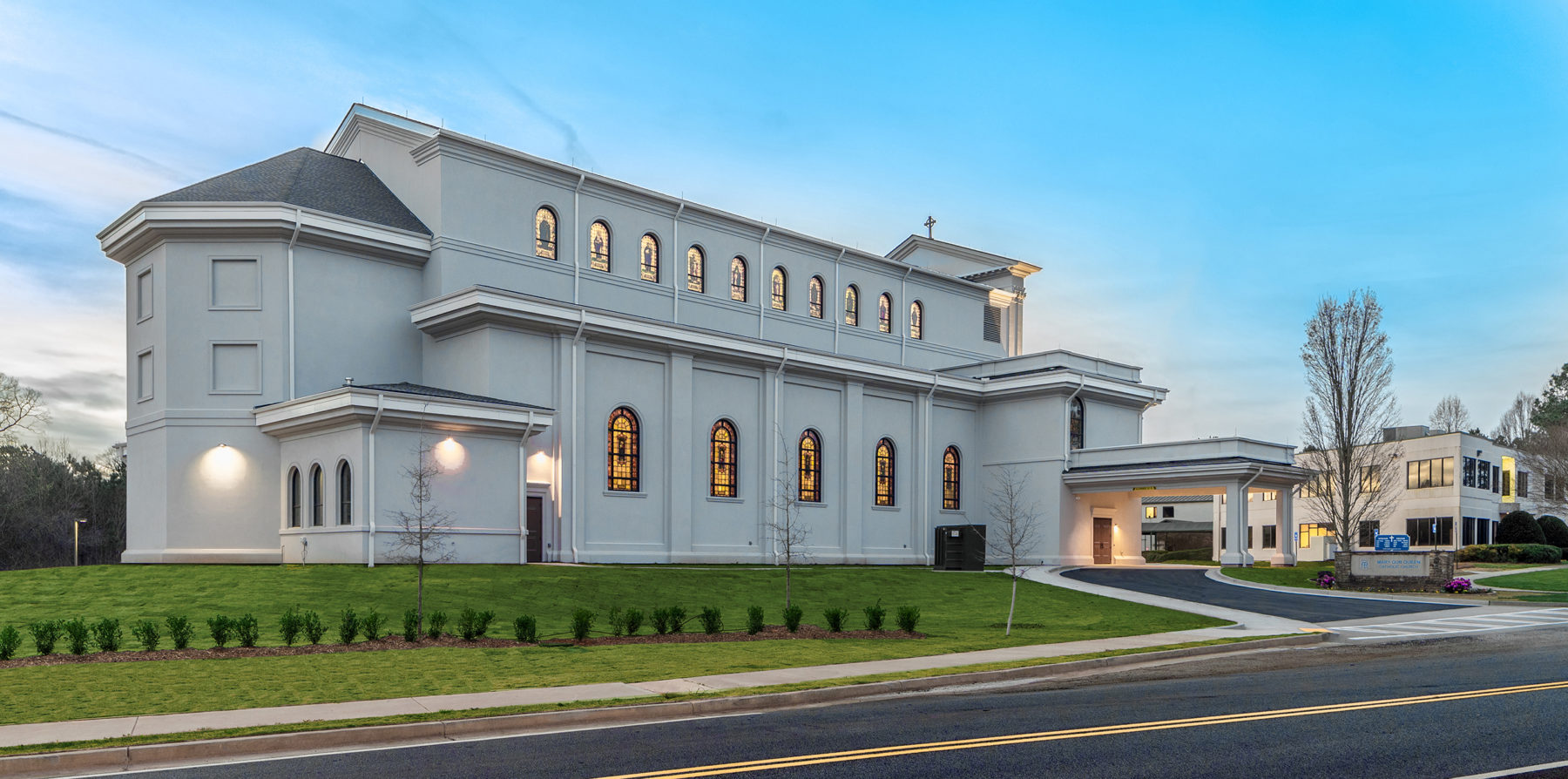 Church exterior classical basilica church with clerestory stained glass windows and porte cochere by Harrison Design