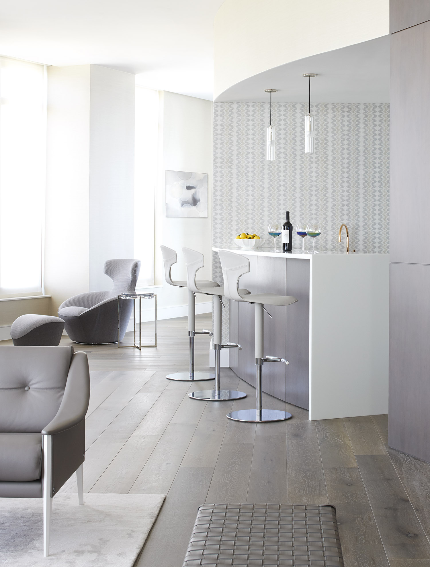Sleek bar corner found in a contemporary Atlanta pied-a-terre designed by Harrison Design.