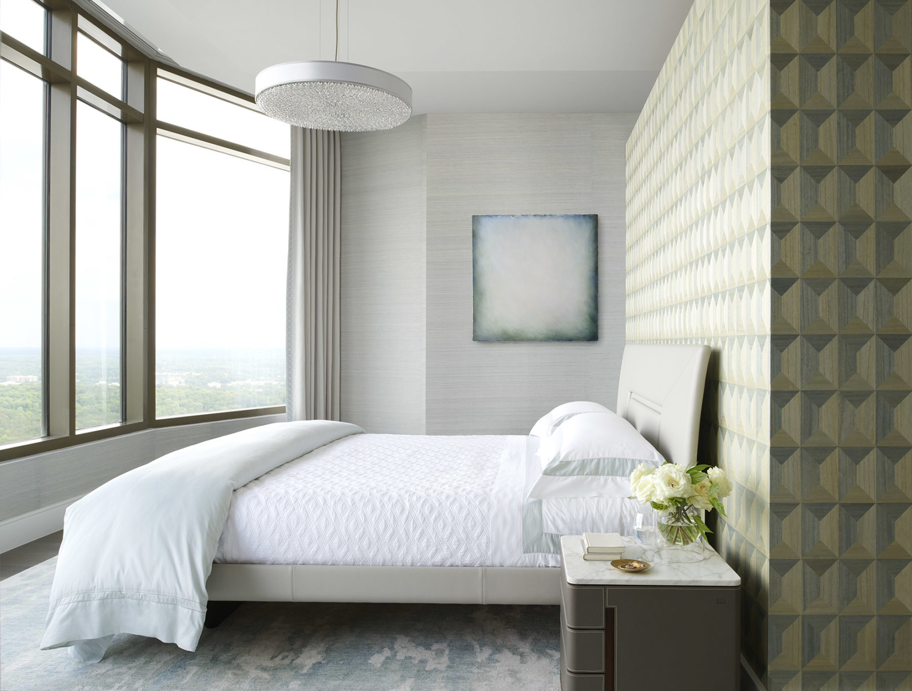 Modern bedroom designed by Harrison Design features soft colors and a distinctive Phillip Jeffries geometric wall pattern.