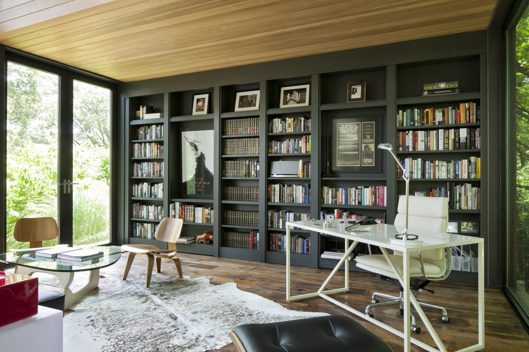 Comfortable Harrison Design atelier has contemporary furniture and desk and black bookcases for reference library
