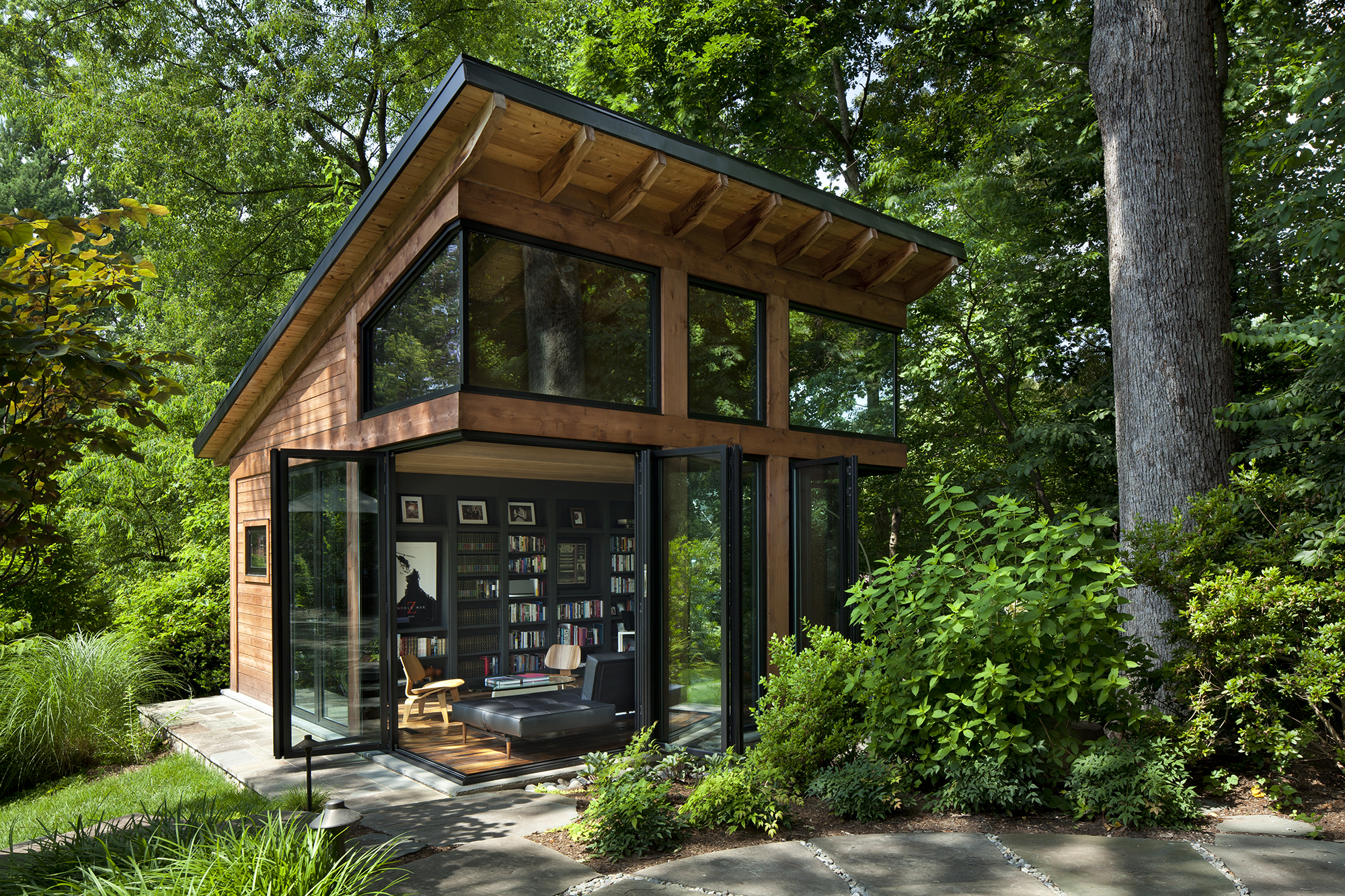 400 square foot studio with Nanawall folding glass doors and window walls connect space by Harrison Design to outdoors